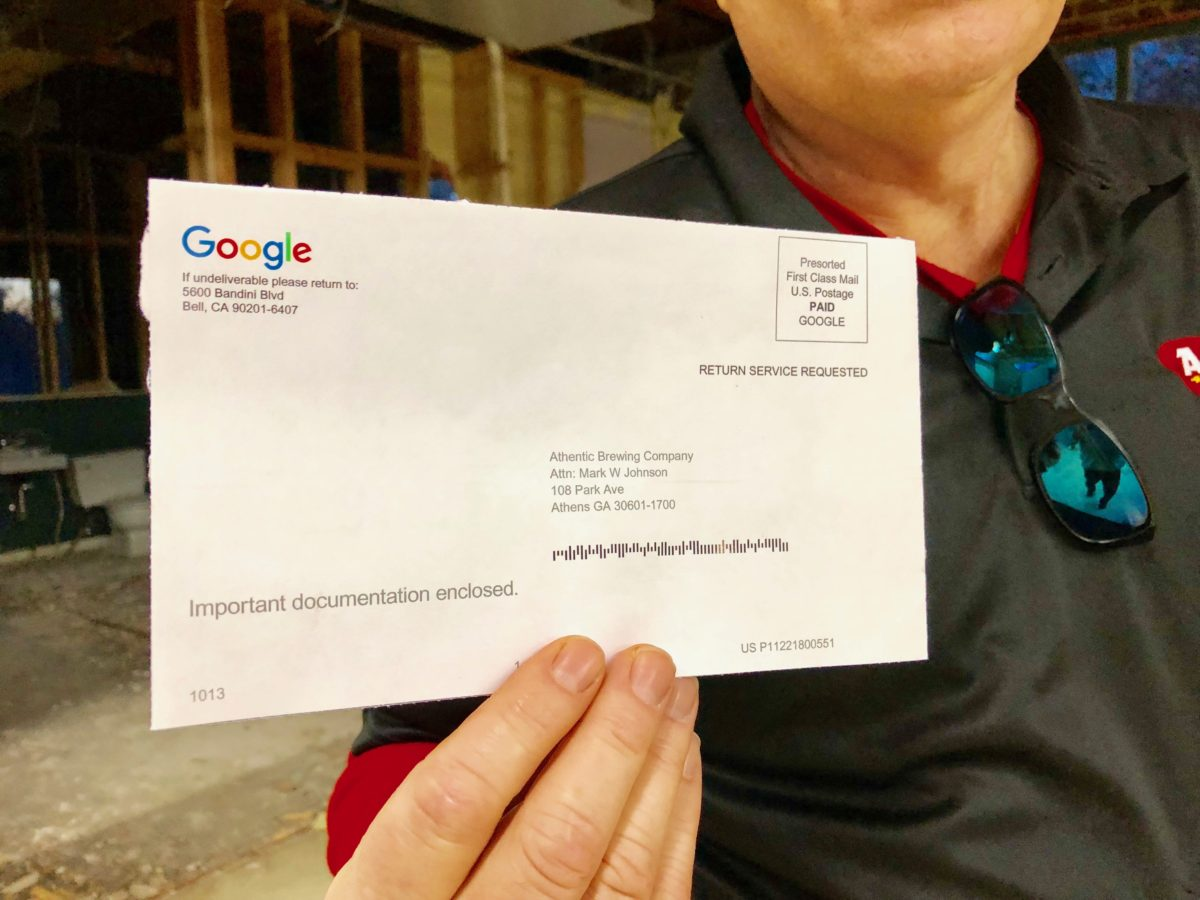 Mark holding google postcard